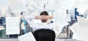 How to declutter piles of paperwork from your office desk
